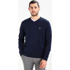 Lacoste Sweter marine. Niebieskie kardigany męskie marki Lacoste, m, z bawełny. W wyprzedaży za 343,20 zł.