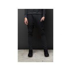 Spodnie dresowe męskie: Spodnie z obniżonym krokiem  SZARY MELANŻ 