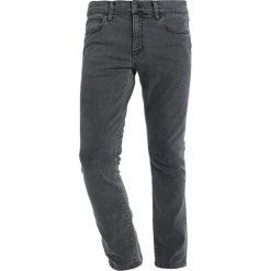 Spodnie męskie: Carhartt WIP REBEL PANT MARGATE Jeansy Slim Fit black stone bleached