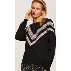 Bluza z ozdobnymi taśmami - Czarny. Czarne bluzy damskie marki House, l. Za 89,99 zł.