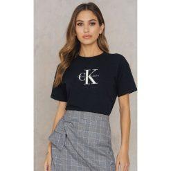 Calvin Klein T-shirt Teco True Icon - Black. Czarne t-shirty damskie Calvin Klein, z nadrukiem, z bawełny. Za 202,95 zł.