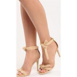 Beżowe Sandały Staple. Brązowe sandały damskie marki Born2be, z materiału, na wysokim obcasie, na obcasie. Za 69,99 zł.
