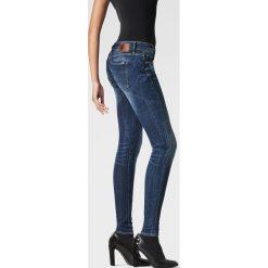 G-Star Raw - Jeansy. Niebieskie jeansy damskie rurki marki G-Star RAW, z obniżonym stanem. W wyprzedaży za 329,90 zł.