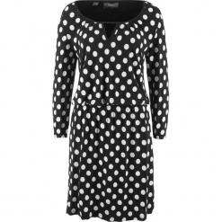 Sukienka shirtowa z tunelem bonprix czarno-biały w kropki. Niebieskie sukienki z falbanami marki DOMYOS, z elastanu, street, z okrągłym kołnierzem. Za 49,99 zł.