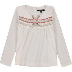 Koszulka w kolorze białym. Białe bluzki dziewczęce z długim rękawem marki Marc O'Polo Junior, z nadrukiem, z okrągłym kołnierzem. W wyprzedaży za 82,95 zł.