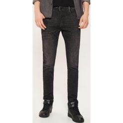 Jeansy slim - Czarny. Czarne jeansy męskie slim House. Za 99,99 zł.