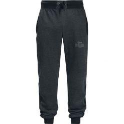 Lonsdale London Heckfield Spodnie dresowe ciemnoszary (Anthracite). Szare spodnie dresowe męskie marki Lonsdale London, z nadrukiem, z dresówki. Za 144,90 zł.