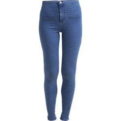 Topshop JONI NEW Jeans Skinny Fit mid denim. Niebieskie jeansy damskie marki Topshop, z bawełny. Za 209,00 zł.