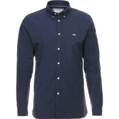 Lacoste Koszula marine. Szare koszule męskie marki Lacoste, l, w paski, z bawełny, z klasycznym kołnierzykiem, z długim rękawem. Za 409,00 zł.