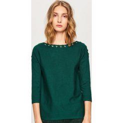 Sweter z ozdobnym wiązaniem - Khaki. Białe swetry klasyczne damskie marki Reserved, l. Za 69,99 zł.
