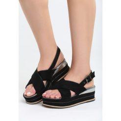 Czarne Sandały Halfway To Paradise. Czarne sandały damskie marki Born2be, z materiału, na koturnie. Za 69,99 zł.