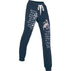 Spodnie sportowe, długie, Level 1 bonprix ciemnoniebieski z nadrukiem. Niebieskie spodnie dresowe damskie marki bonprix, z nadrukiem. Za 89,99 zł.