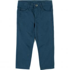 Spodnie. Niebieskie chinosy chłopięce REBELS, z bawełny. Za 39,90 zł.