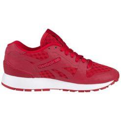 Buty sportowe w kolorze czerwonym. Brązowe buty sportowe męskie marki Reebok, z materiału. W wyprzedaży za 289,95 zł.