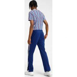 Champion Reverse Weave SPECIAL SEMI DULL Spodnie treningowe blue. Niebieskie spodnie dresowe męskie Champion Reverse Weave, z dresówki. Za 359,00 zł.