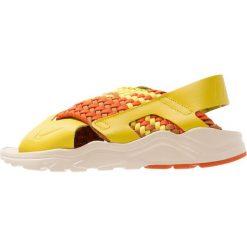Nike Sportswear AIR HUARACHE RUN Sandały bright citron/monarch/campfire orange/camper green/beach. Żółte sandały damskie Nike Sportswear, z materiału. Za 419,00 zł.