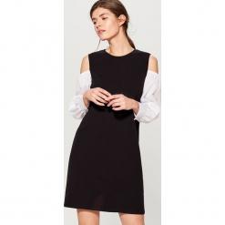 Sukienka z kontrastowymi rękawami - Czarny. Czarne sukienki z falbanami marki Mohito, m, z kontrastowym kołnierzykiem. W wyprzedaży za 59,99 zł.