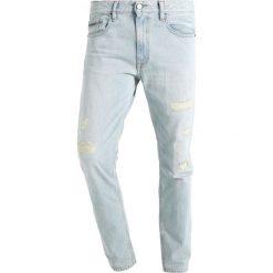 Calvin Klein Jeans Jeansy Slim Fit berlin blue. Niebieskie jeansy męskie relaxed fit marki Calvin Klein Jeans, z bawełny. W wyprzedaży za 454,30 zł.