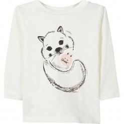 """Koszulka """"Sita"""" w kolorze białym. Białe bluzki dziewczęce bawełniane marki Name it Baby, z nadrukiem, z okrągłym kołnierzem, z długim rękawem. W wyprzedaży za 25,95 zł."""