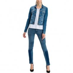 """Dżinsy """"Anya"""" - Slim fit - w kolorze niebieskim. Niebieskie spodnie z wysokim stanem marki Cross Jeans, z aplikacjami. W wyprzedaży za 127,95 zł."""