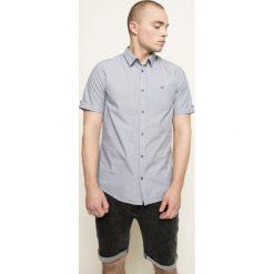 Medicine - Koszula Indigo Resort. Niebieskie koszule męskie na spinki MEDICINE, m, z bawełny, z klasycznym kołnierzykiem, z krótkim rękawem. W wyprzedaży za 59,90 zł.
