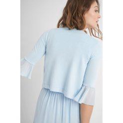 Krótki sweter z falbanką. Brązowe swetry klasyczne damskie marki Orsay, s, z dzianiny. Za 79,99 zł.