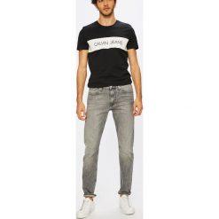Calvin Klein Jeans - Jeansy CKJ 026. Szare jeansy męskie slim marki Calvin Klein Jeans. W wyprzedaży za 399,90 zł.