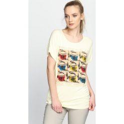 Jasnożółty T-shirt Fun And Games. Żółte bluzki damskie marki Mohito, l, z dzianiny. Za 9,99 zł.