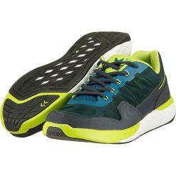 """Buty sportowe """"Terrafly ST"""" w kolorze szaro-zielonym. Szare halówki męskie marki Hummel, z materiału. W wyprzedaży za 214,95 zł."""