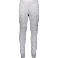 Spodnie dresowe w kolorze szarym. Szare joggery męskie marki adidas Performance, z dresówki. W wyprzedaży za 165,95 zł.