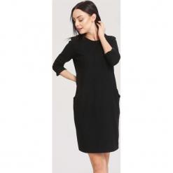 Czarna Sukienka Docility. Sukienki małe czarne marki other, xl, oversize. Za 79,99 zł.