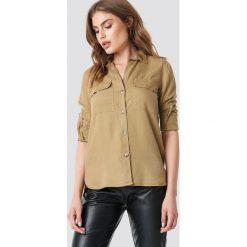 MANGO Koszula Roma - Beige. Brązowe koszule wiązane damskie Mango, z lyocellu, z dekoltem na plecach. Za 141,95 zł.