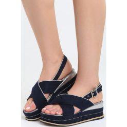 Niebieskie Sandały Halfway To Paradise. Niebieskie sandały damskie marki Born2be, z materiału, na koturnie. Za 69,99 zł.