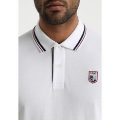 GANT TECH PREP RUGGER Koszulka polo white. Niebieskie koszulki polo marki GANT. Za 509,00 zł.