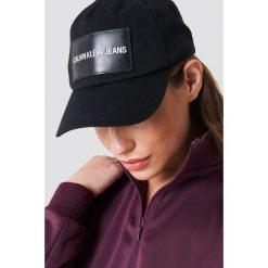 Calvin Klein Czapka Calvin Klein Jeans Cap W - Black. Czarne czapki z daszkiem damskie Calvin Klein, z jeansu. Za 141,95 zł.