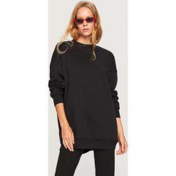 Długa bluza - Czarny. Czarne długie bluzy damskie marki KALENJI, z elastanu, z długim rękawem. Za 89,99 zł.