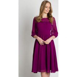 Zwiewna fioletowa sukienka odcinana w pasie BIALCON. Fioletowe sukienki BIALCON, m, eleganckie, midi, rozkloszowane. W wyprzedaży za 339,00 zł.