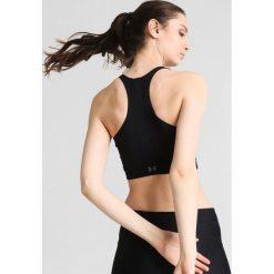 Under Armour Koszulka sportowa black. Czarne topy sportowe damskie marki Under Armour, l, z elastanu. W wyprzedaży za 174,30 zł.