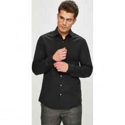 Calvin Klein - Koszula. Czarne koszule męskie na spinki marki Calvin Klein, z bawełny, z klasycznym kołnierzykiem, z długim rękawem. Za 299,90 zł.