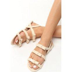 Beżowe Sandały Little Rock. Brązowe sandały damskie marki Born2be, z lakierowanej skóry, na obcasie. Za 19,99 zł.
