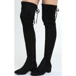 Czarne Kozaki Decorous. Czarne buty zimowe damskie marki Born2be, na płaskiej podeszwie. Za 159,99 zł.