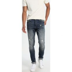Only & Sons ONSAVI Jeansy Slim Fit dark blue denim. Brązowe jeansy męskie marki Only & Sons, l, z poliesteru. Za 209,00 zł.