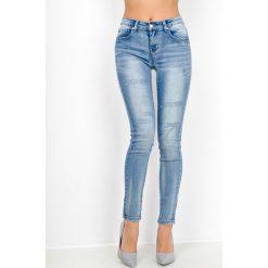 Rurki damskie: Jeansowe rurki z przetarciami