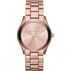 """Zegarek kwarcowy """"Runway Slim"""" w kolorze różowozłotym. Żółte, analogowe zegarki damskie marki Michael Kors, ze stali. W wyprzedaży za 431,95 zł."""