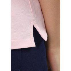 Polo Ralph Lauren Golf REFINED STRETCH Koszulka polo island pink. Czerwone topy sportowe damskie Polo Ralph Lauren Golf, xl, z bawełny. Za 419,00 zł.