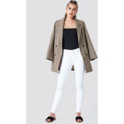 Jeansy damskie: MANGO Wąskie jeansy Olivia - White
