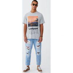 Jeansy loose fit z przetarciami. Szare jeansy męskie relaxed fit Pull&Bear. Za 159,00 zł.