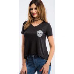 Czarna bluzka z aplikacją 3395. Czarne bluzki na imprezę marki Fasardi, m, z dresówki. Za 39,00 zł.