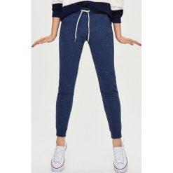 Spodnie dresowe damskie: Dresowe spodnie – Granatowy