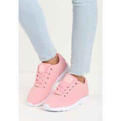 Różowe Buty Sportowe Oris. Fioletowe buty sportowe damskie marki KALENJI, z gumy, do biegania. Za 69,99 zł.
